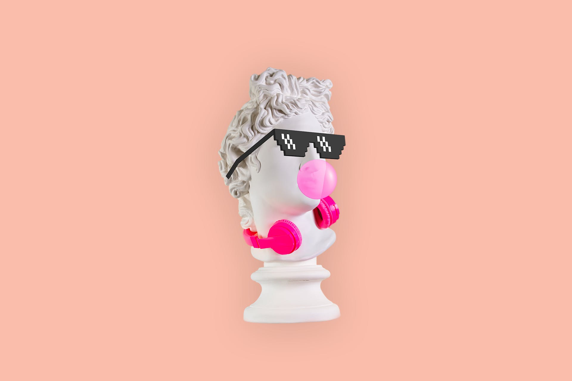 Small ancient statue figurine with sunglasses, bubblegum, and headphones. How marketers can use TikTok blog post
