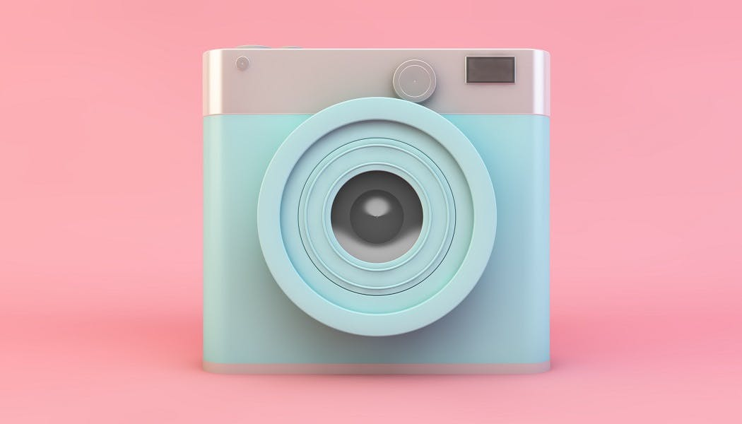 Image of camera on pink background