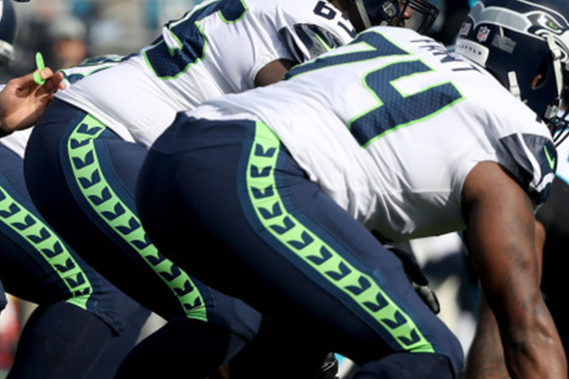 Backview of football players crouching