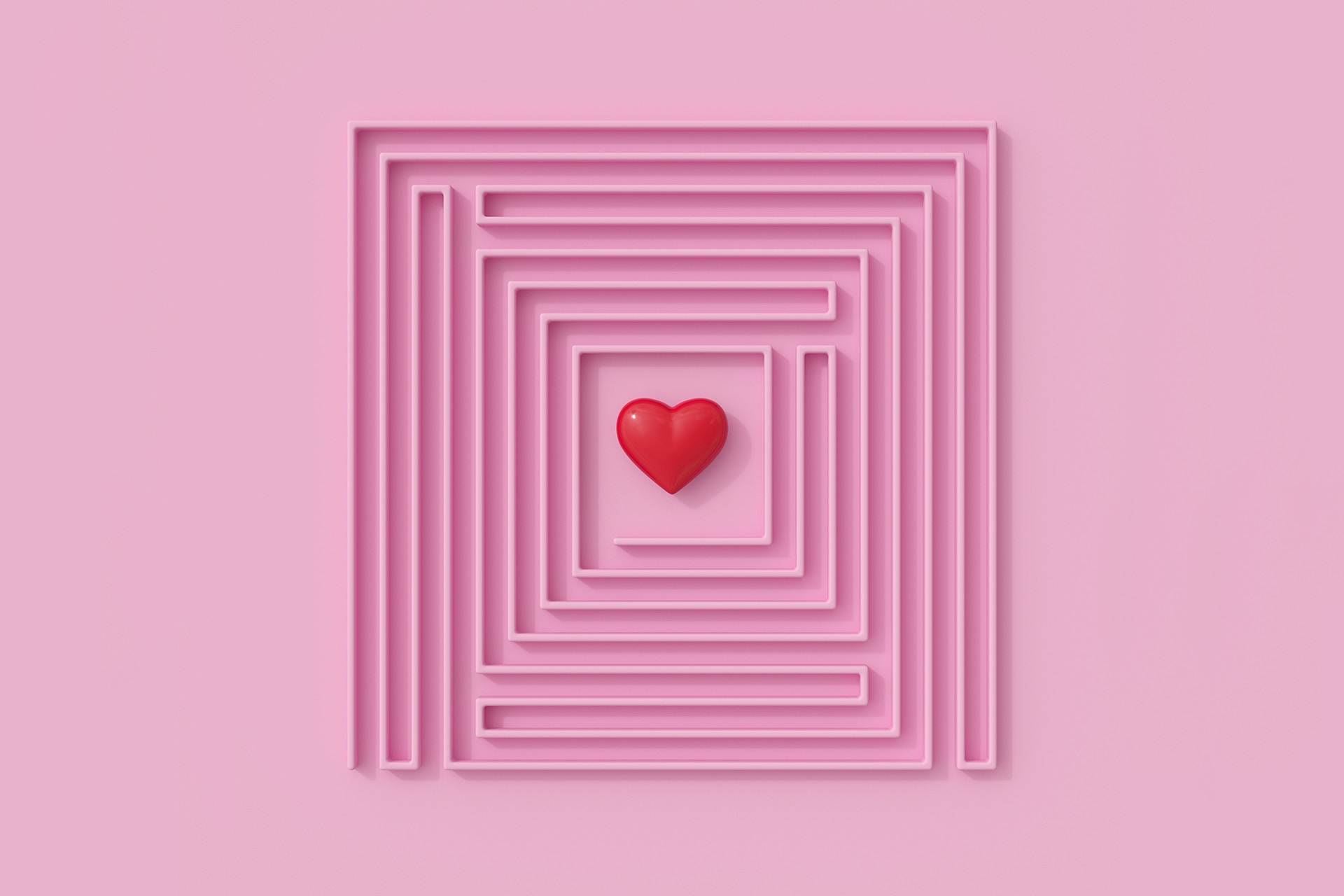 Customer loyalty is hard to achieve, and this image of a maze from above with a heart in the center perfectly represents the tireless journey marketers must embark on to achieve customer loyalty.