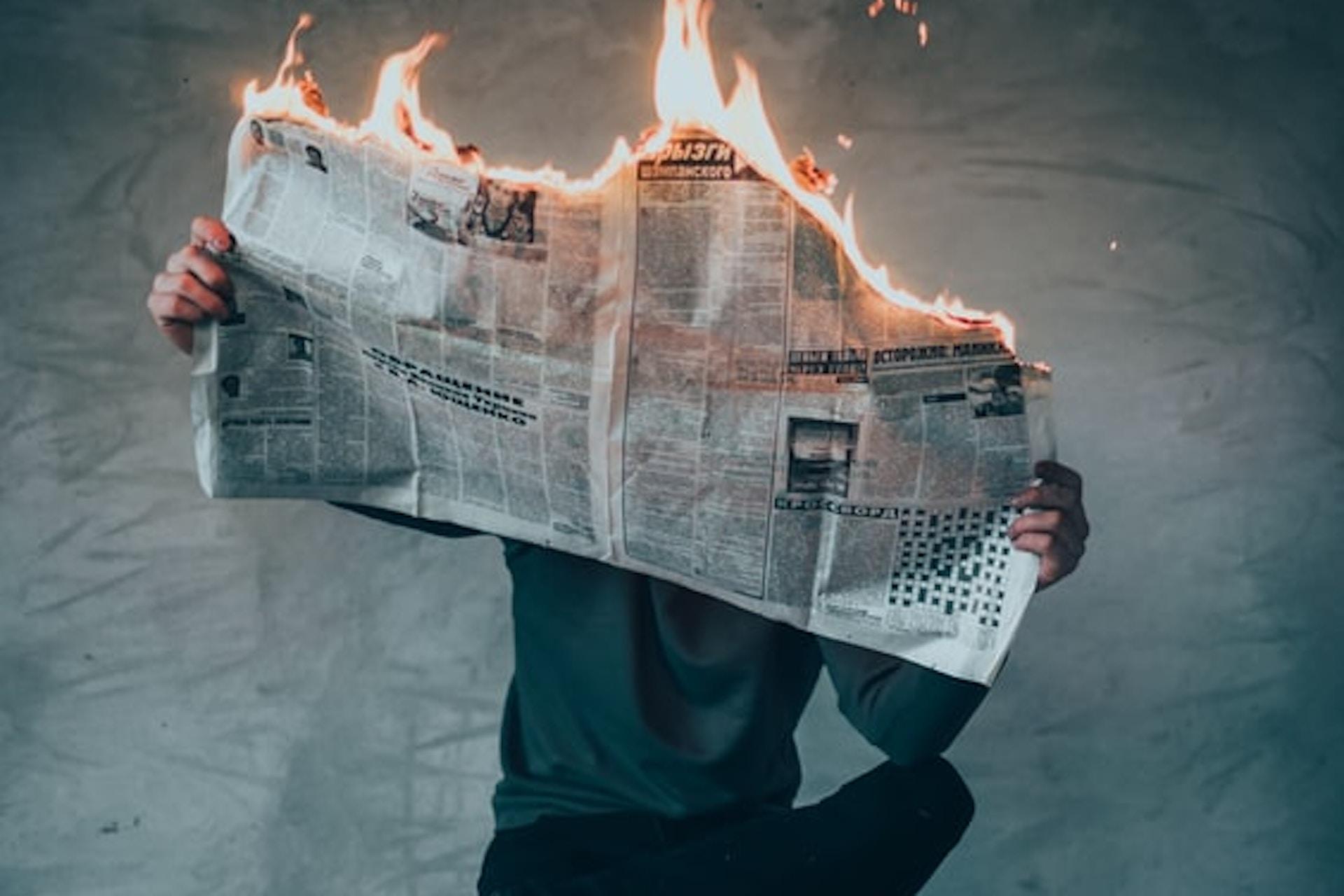 burning newspaper