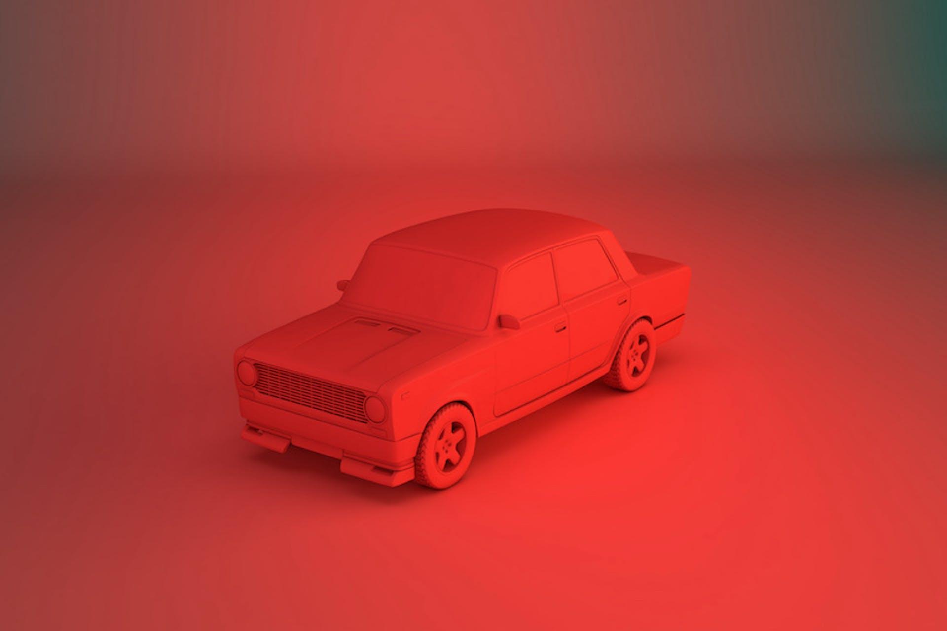 Rotes Auto vor rotem Hintergrund