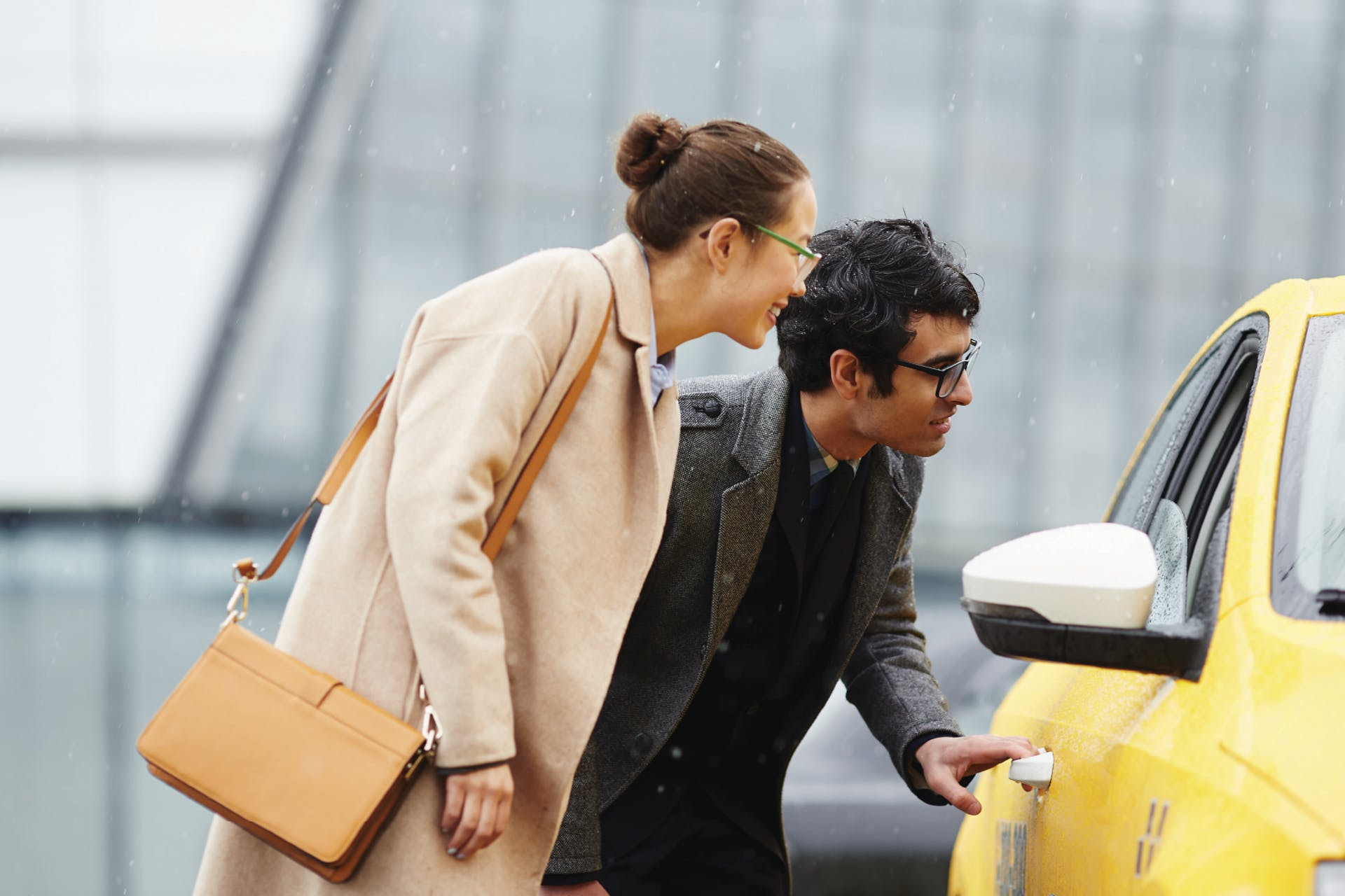 Two businesspeople hailing a cab or ride-sharing service