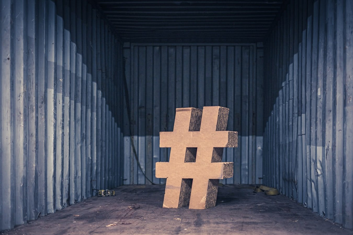 large hashtag sign in a corrugated iron room