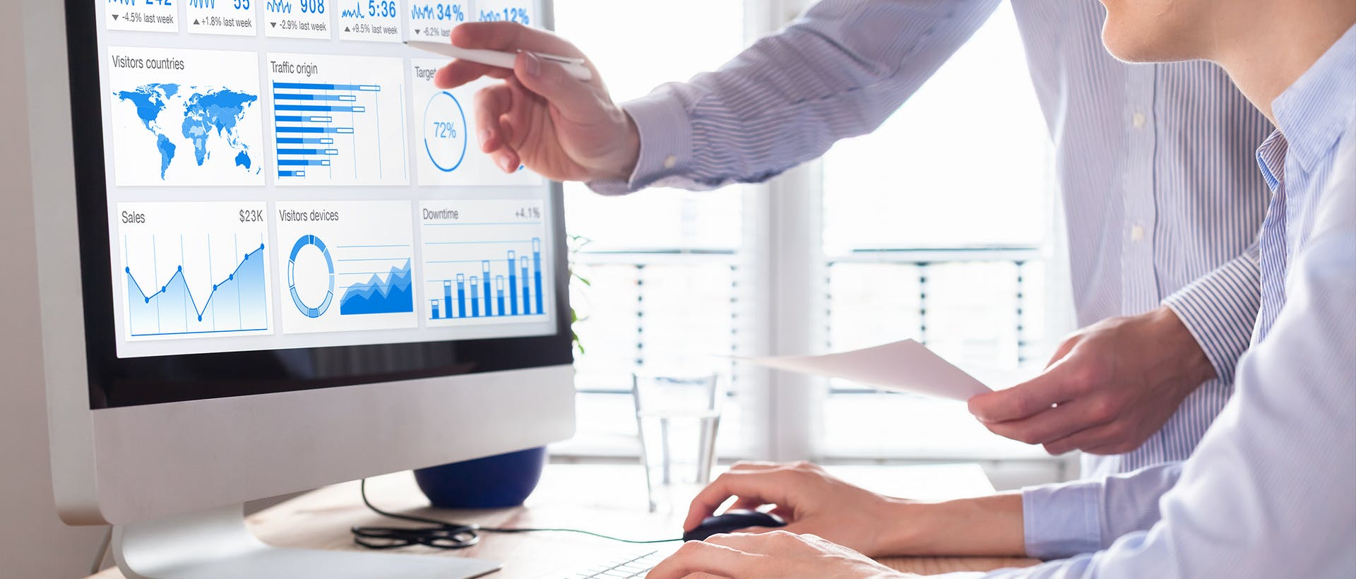 Webinar: People look at a dashboard on a monitor