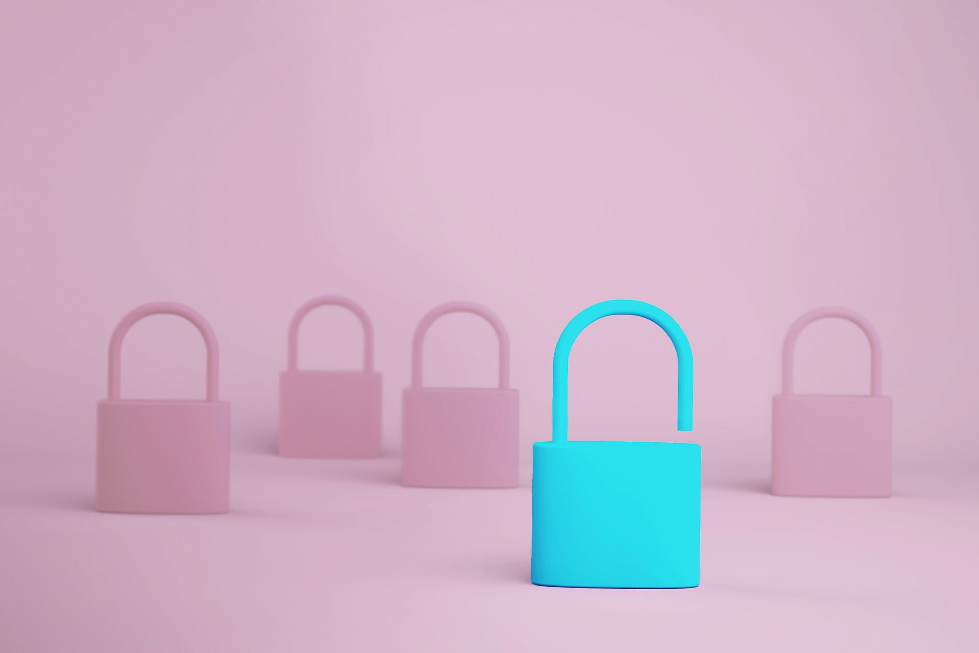 A teal padlock that is unlocked among a bunch of pink padlocks that are closed.