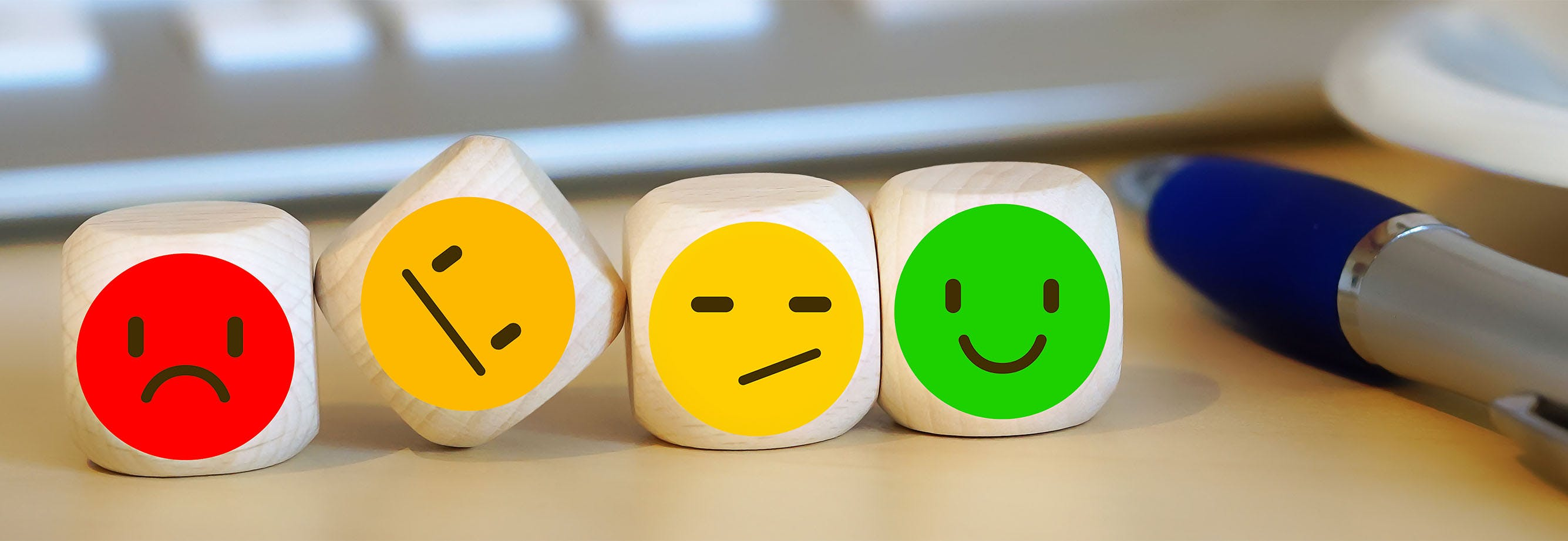 Dice with happy and sad faces on