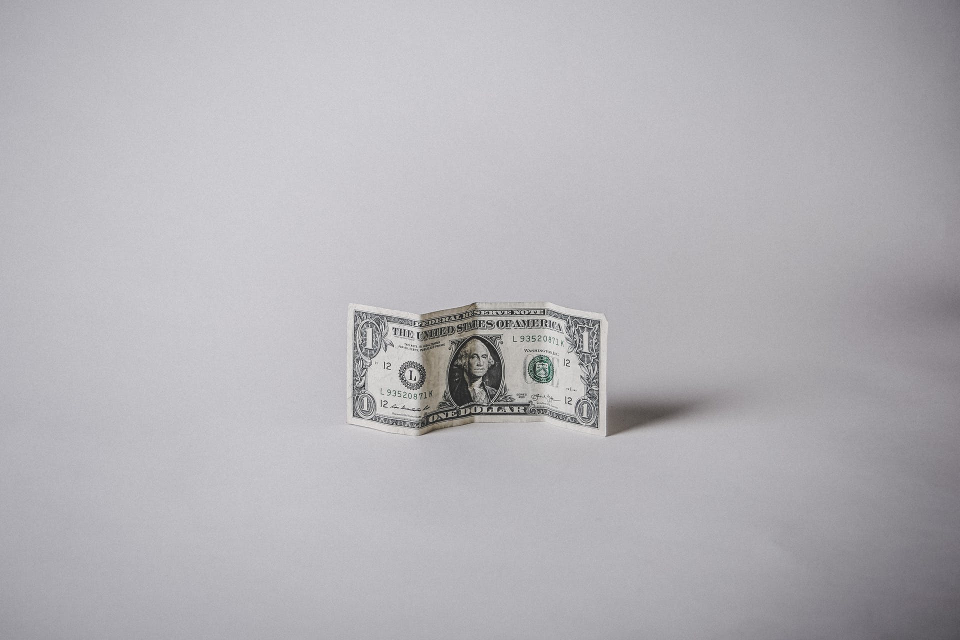 1 US dollar banknote against a white background