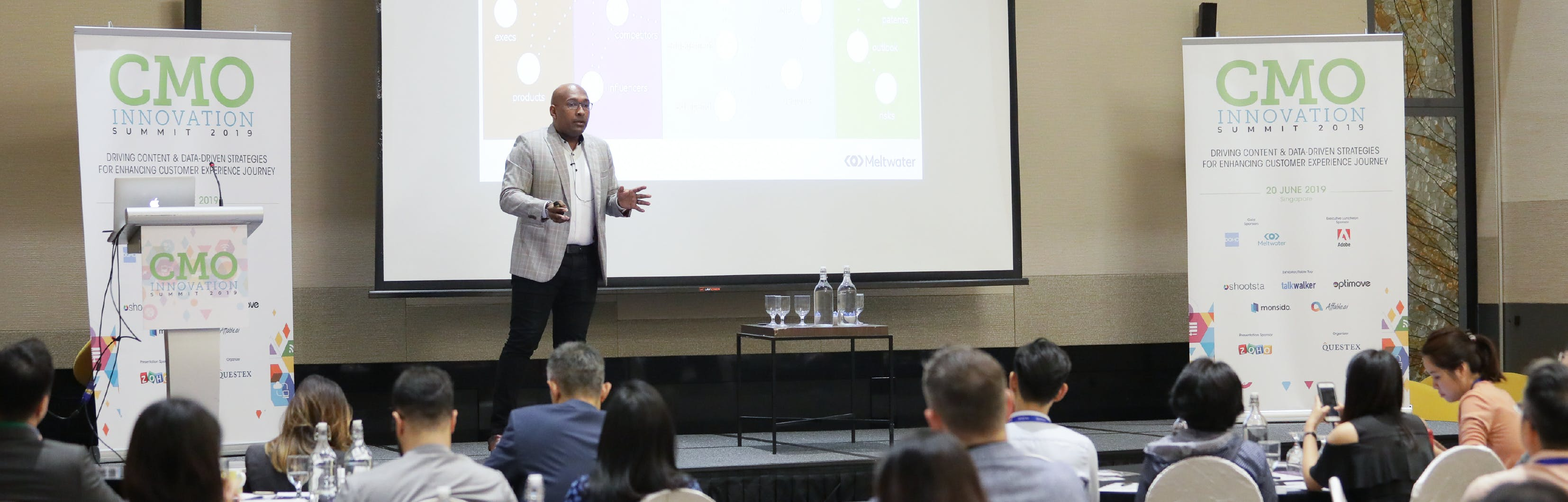 Image of a man presenting at an event