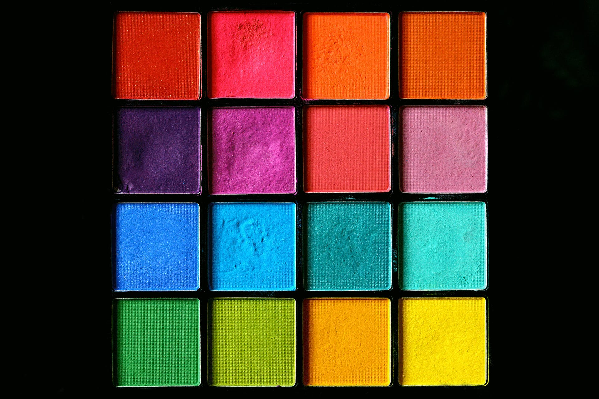 photo of a colorful makeup palette with a black background