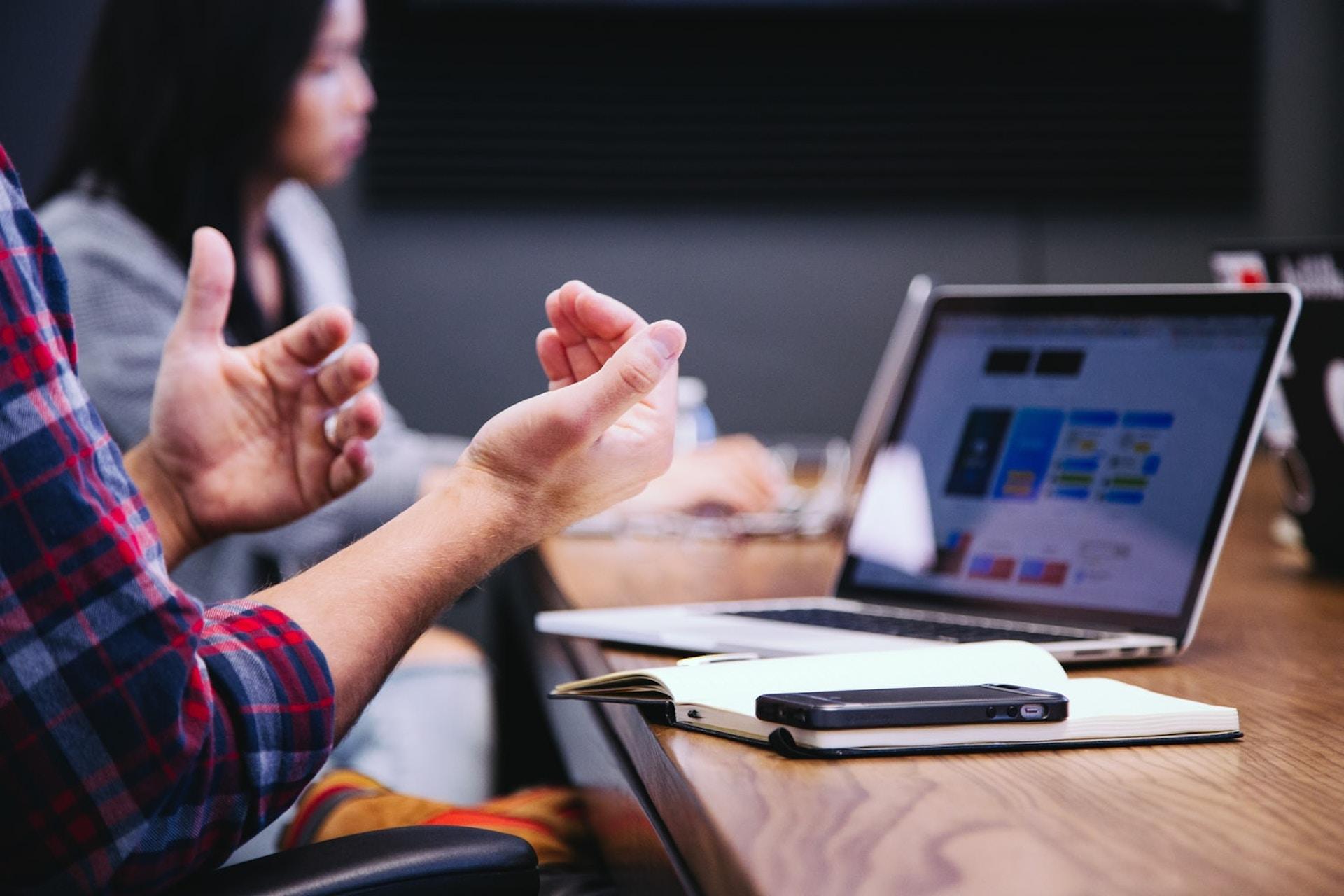 PR agency working laptop hand gesture