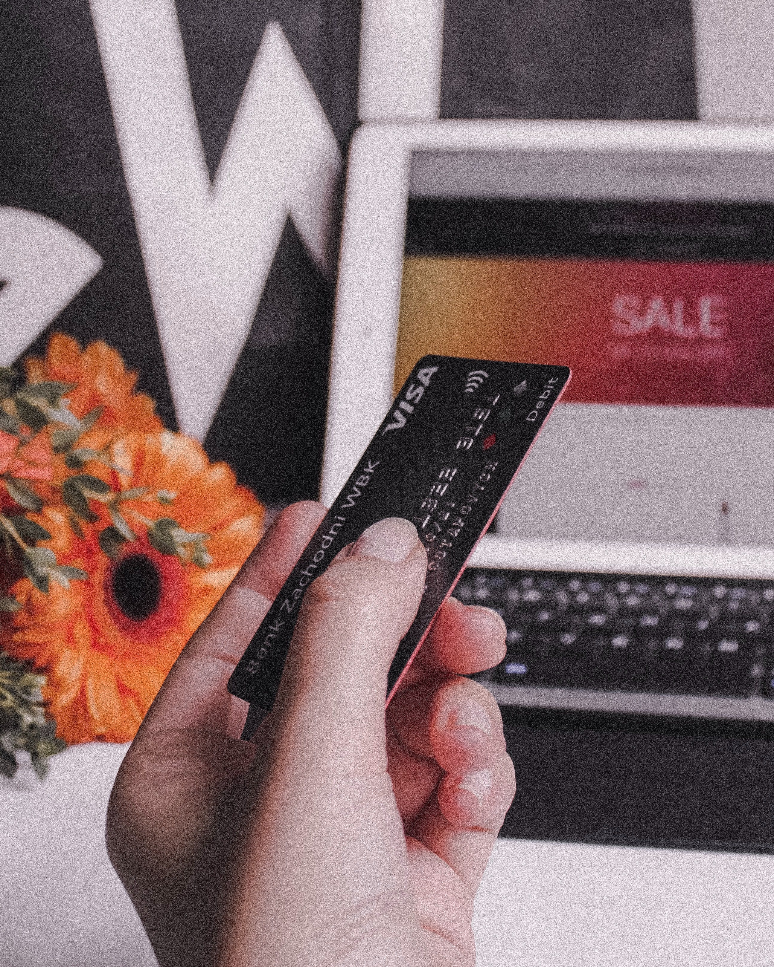 person holding a card to purchase on ecommerce site