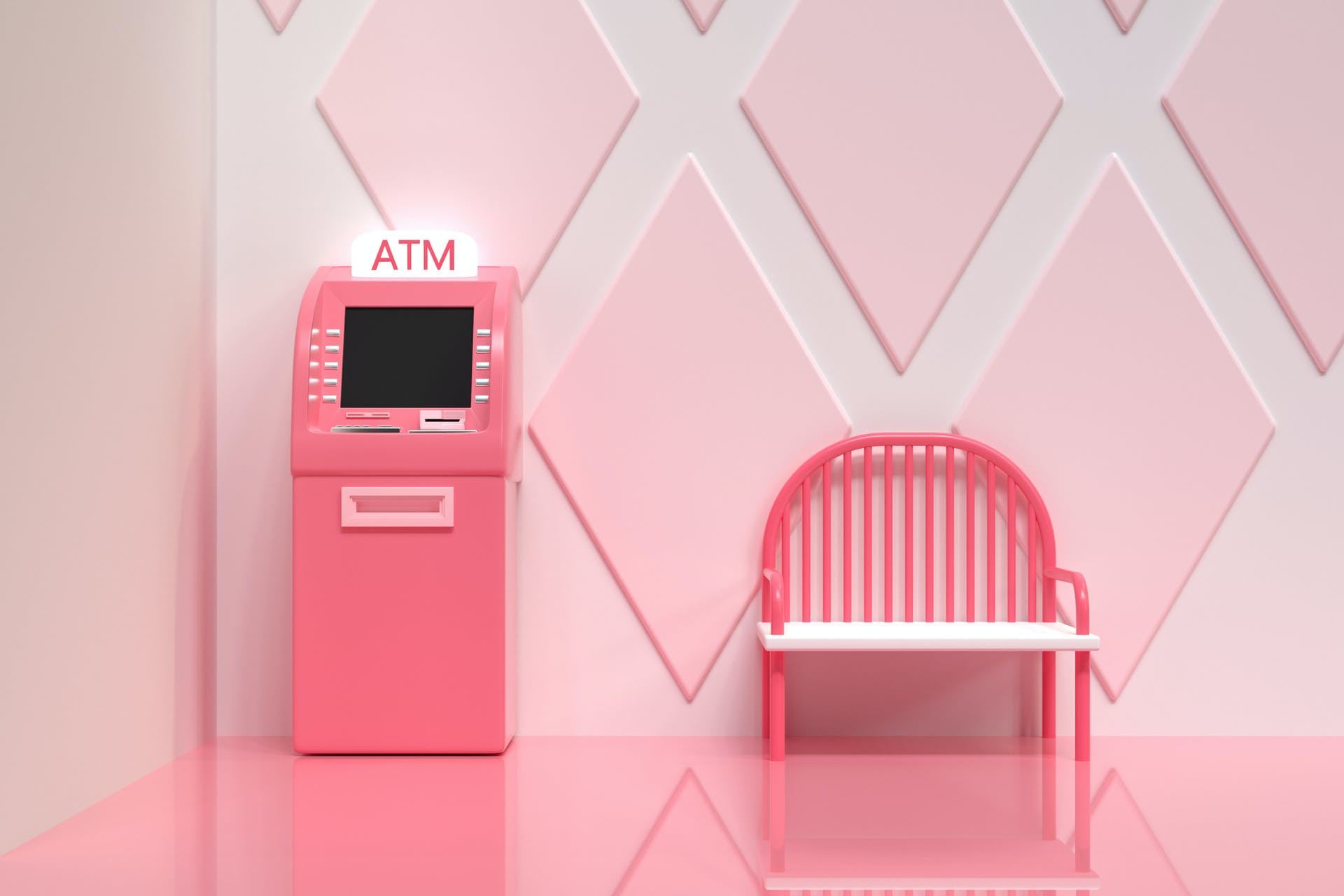 A pink model of an ATM machine next to a pink model bench