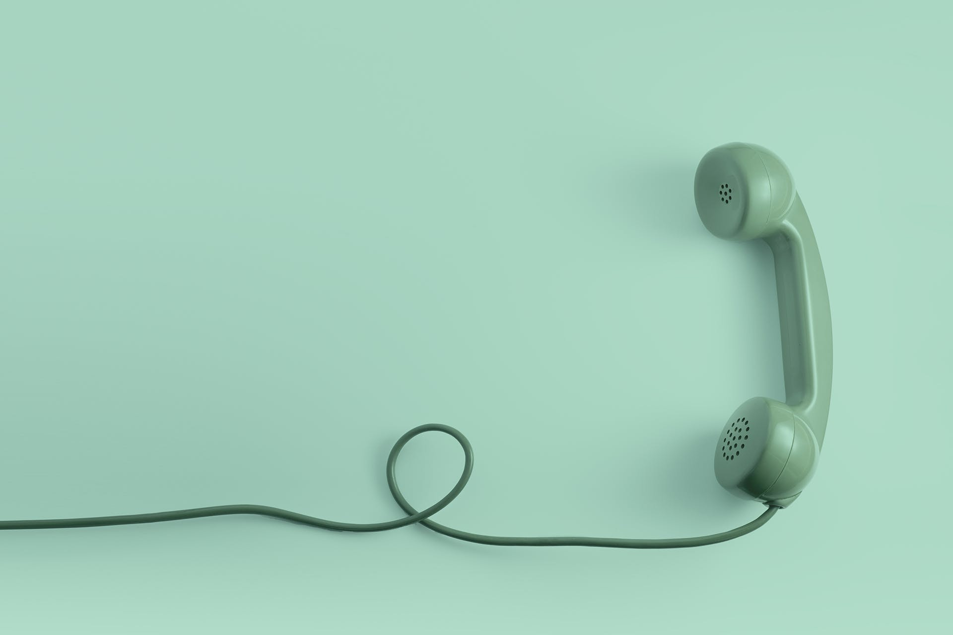 Green old fashioned telephone. Header image for blog post: why word of mouth marketing is important.