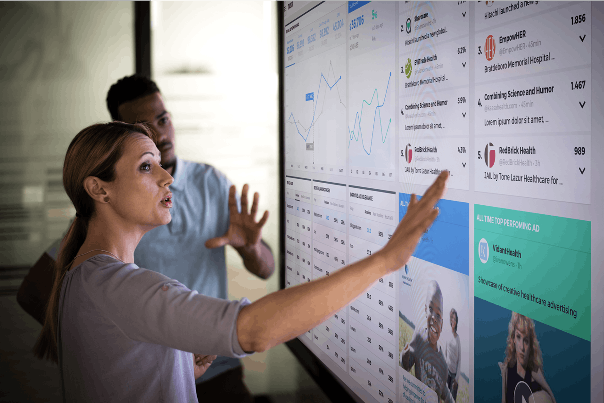 two people looking at a screen for data analysis