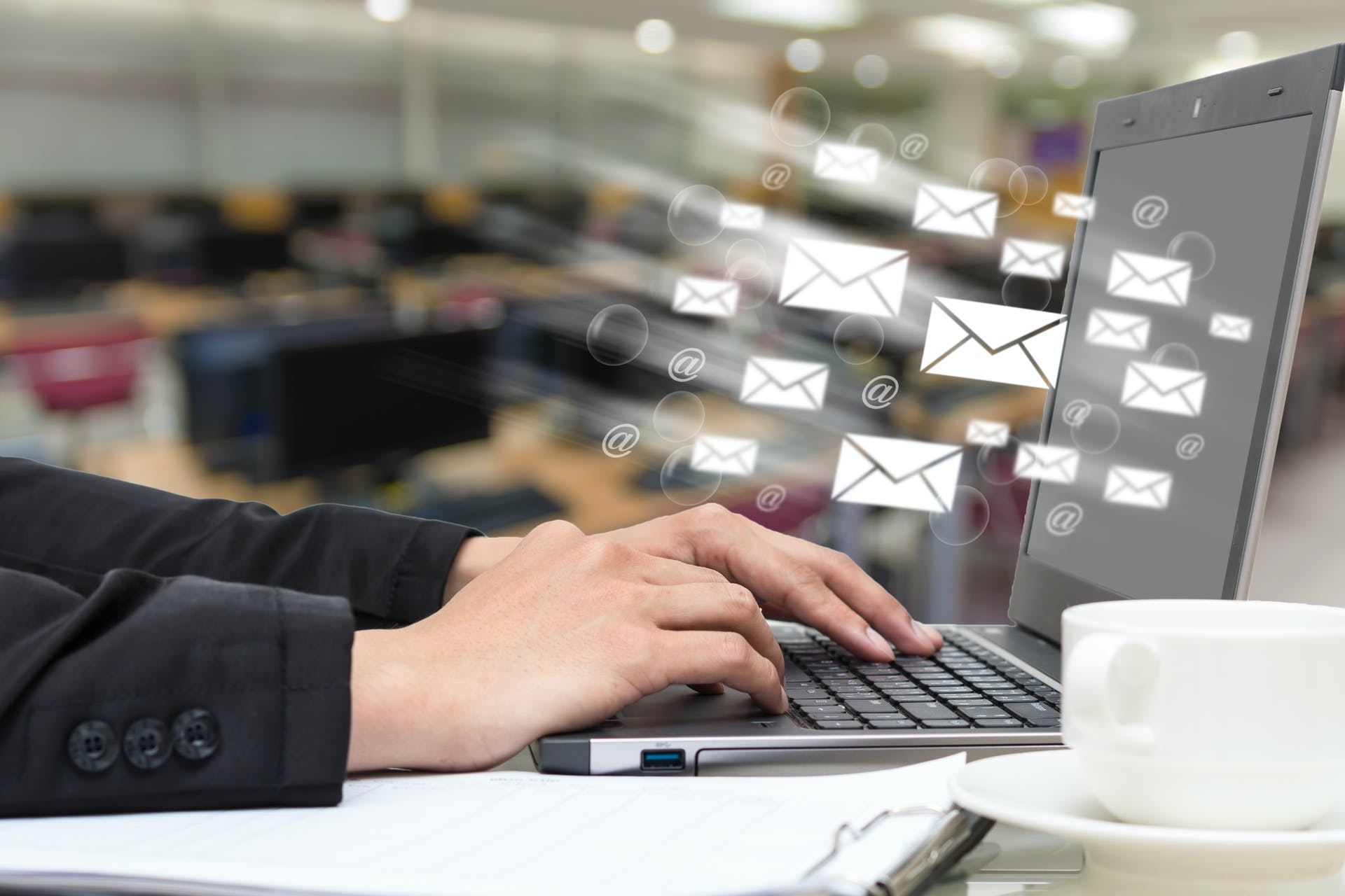 A close up of hands working on an email marketing campaign.