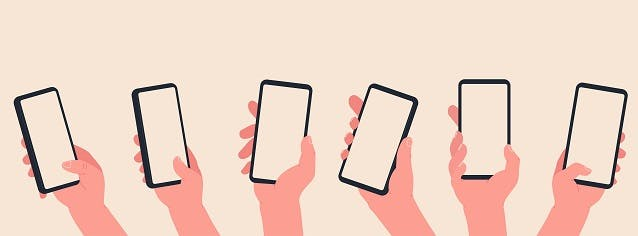 Hands holding mobile phones on orange background