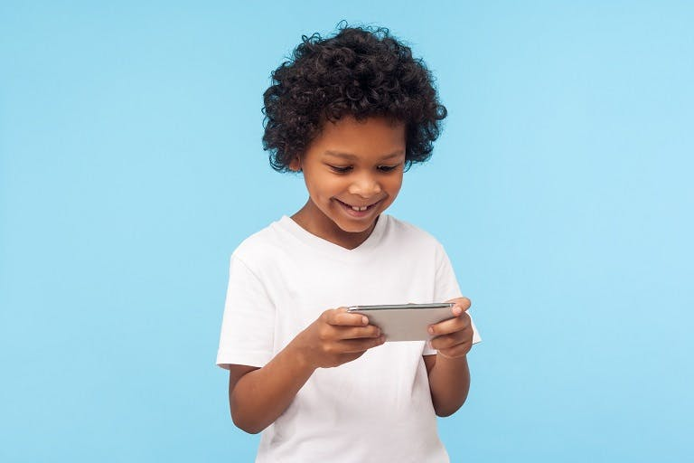 Child playing a game on mobile phone