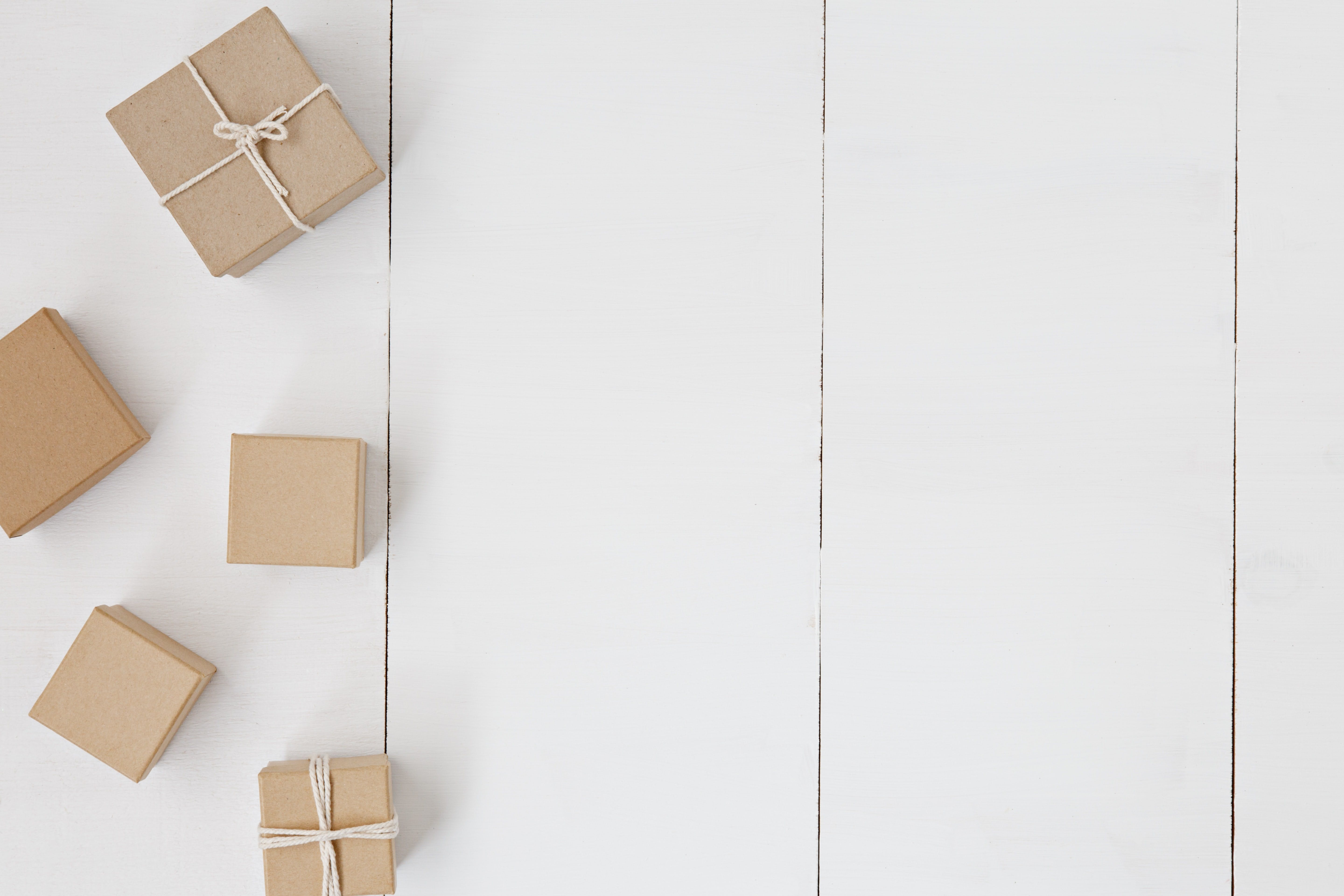 Brown boxes with ribbons on white background. Subscriber only gifts on YouTube is a great idea for keeping people engaged