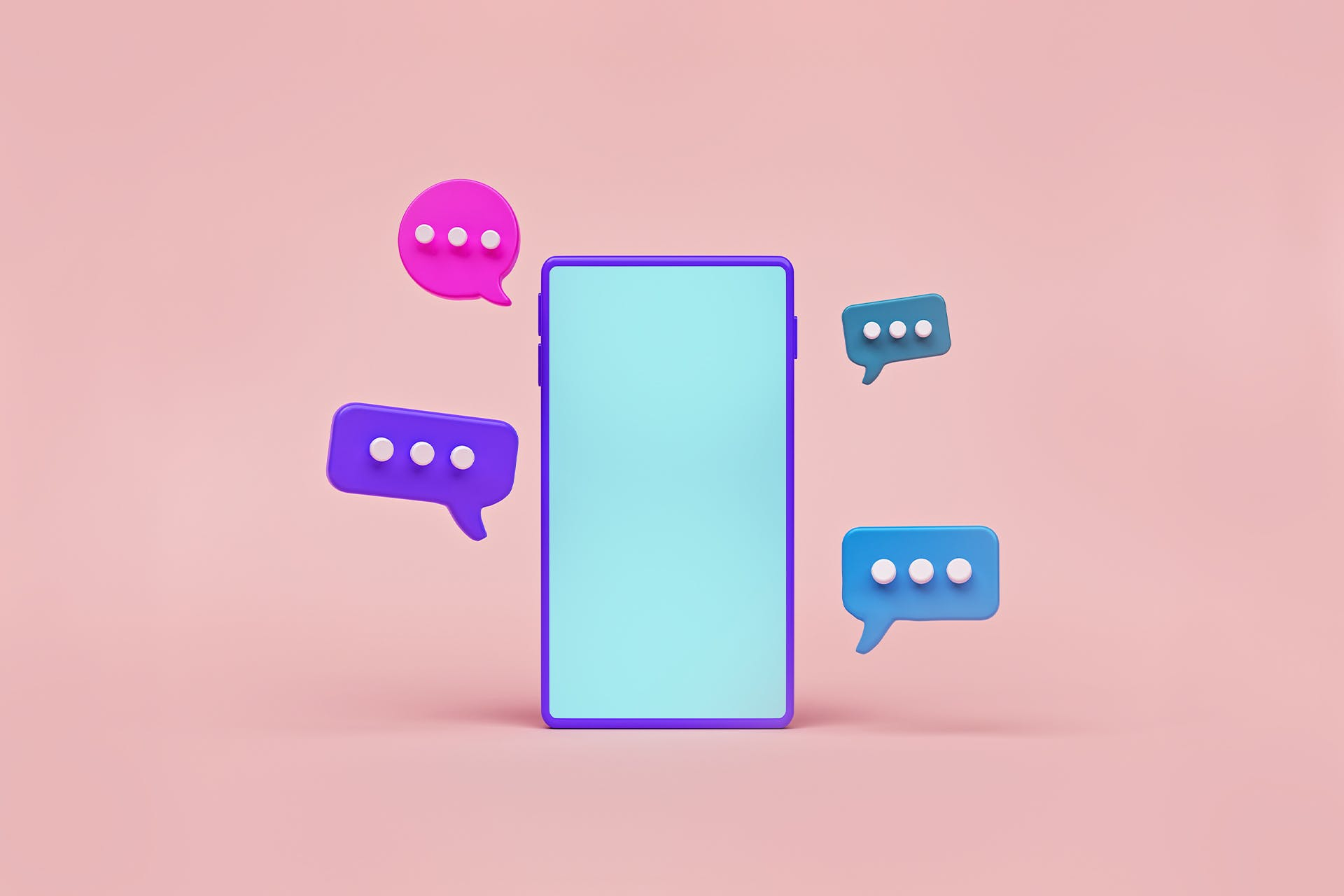 An image of a cartoon phone with stylized chat bubbles appearing around the screen against a solid pink background. Each of the four chat bubbles are a different color, symbolizing the different threads that marketers can engage in on Reddit.
