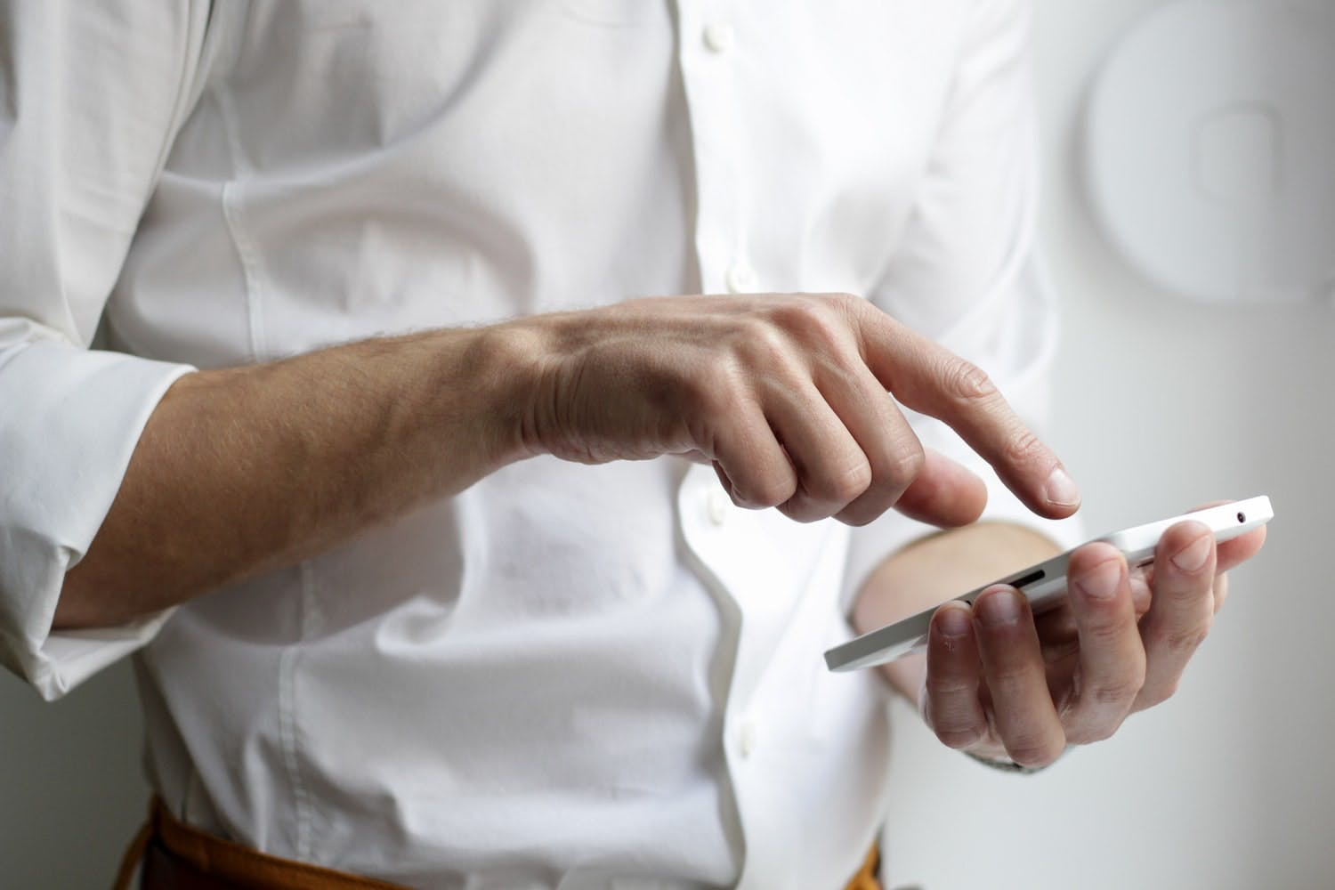 business man tiping on smartphone