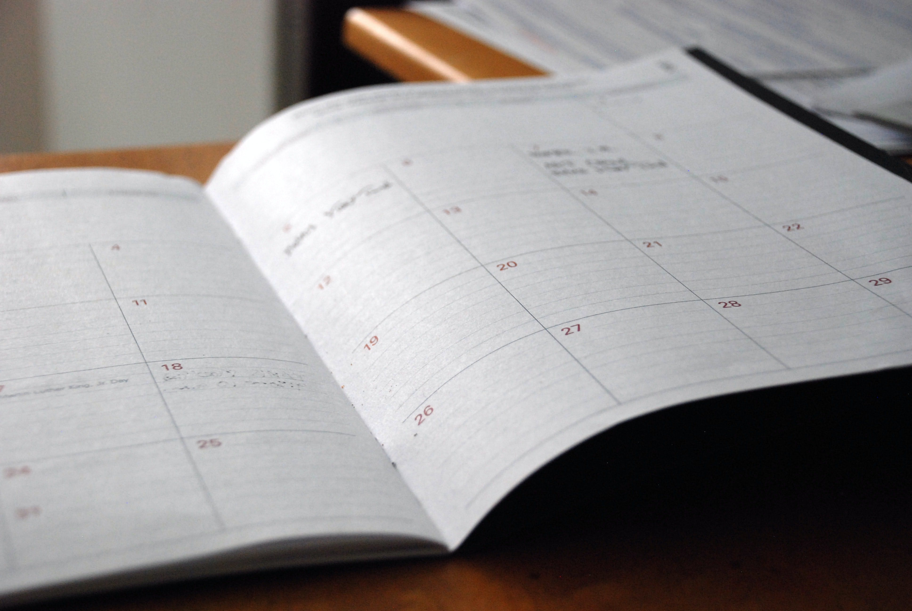 Open monthly planner showing month view of dates. Planning and sticking to a content schedule is essential for growing your YouTube subscriber count
