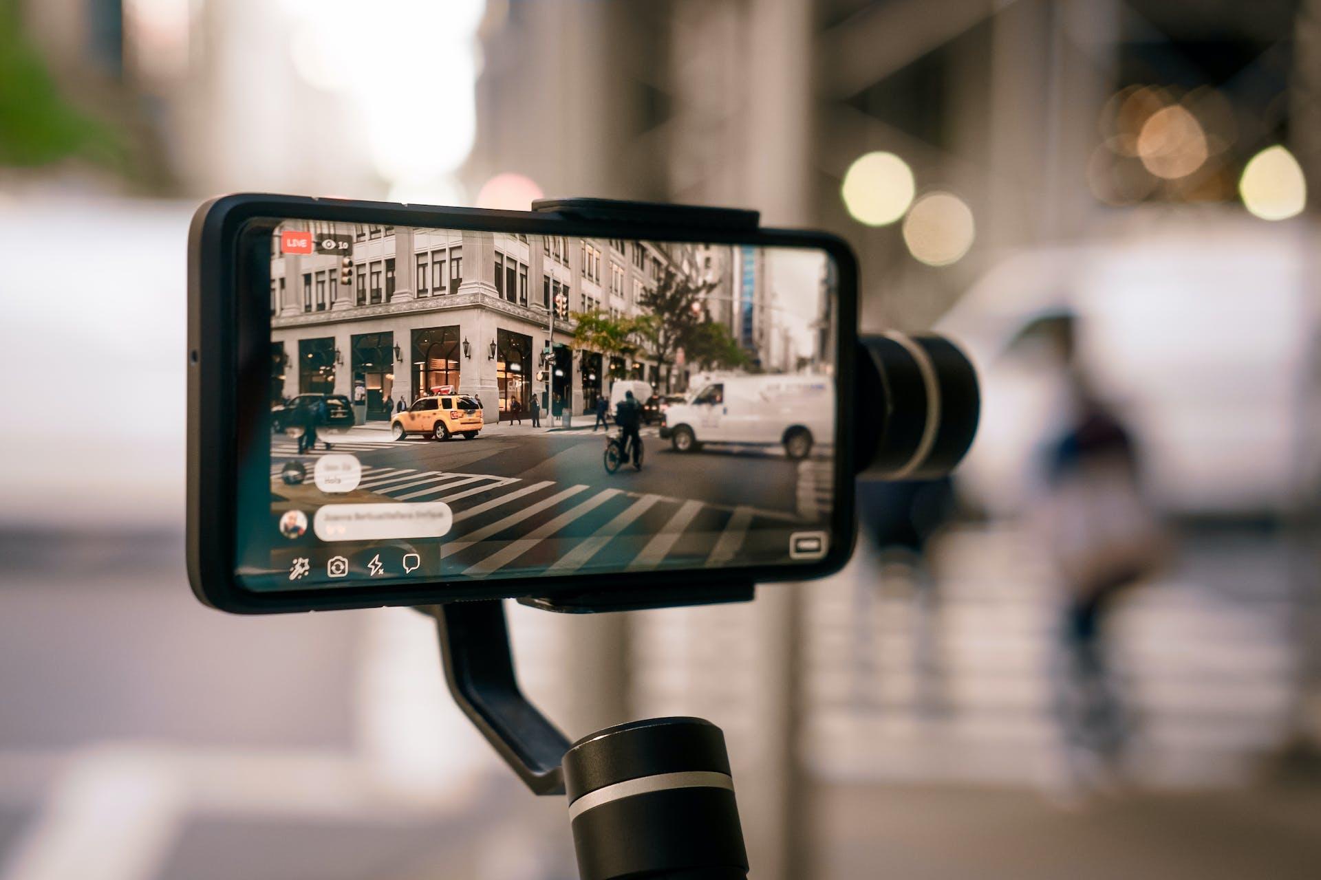 A live video of a street filmed through a mobile phone