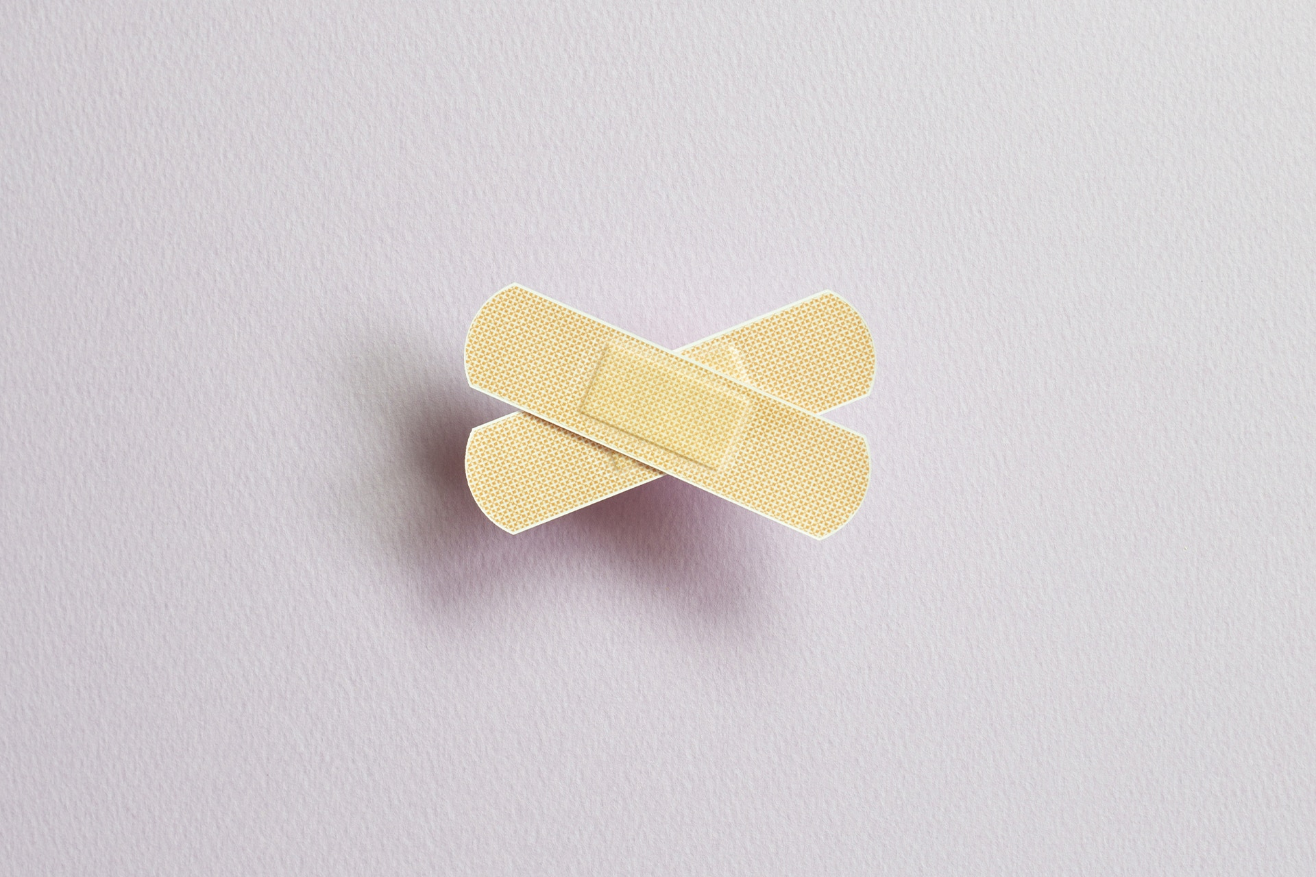 Two bandaids forming a cross shape. Tips for writing a crisis statement blog post