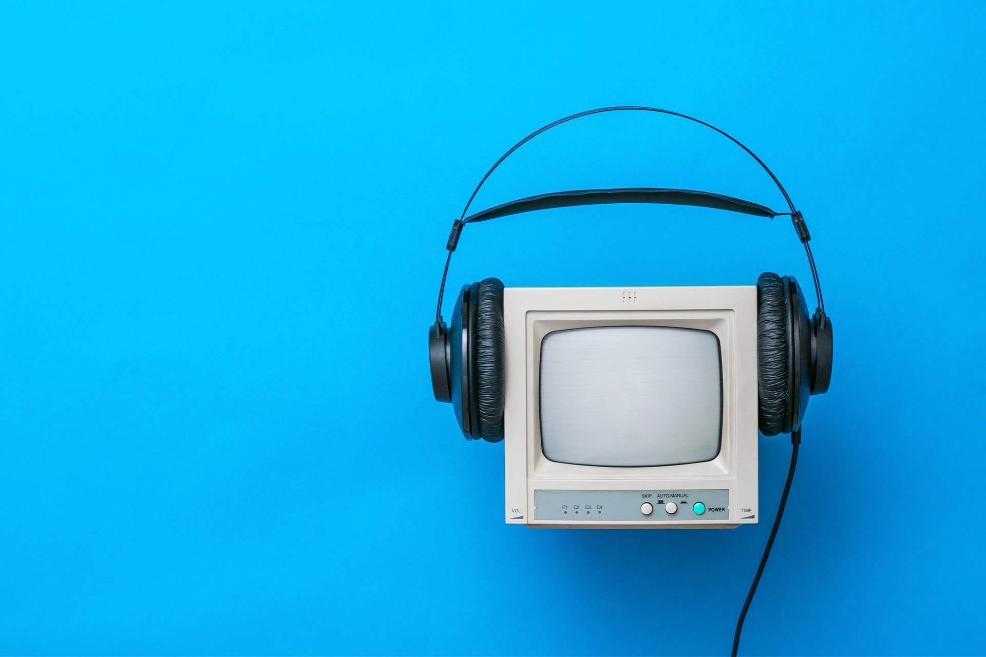 Old fashioned computer with headphones. Blog post: 14 proven PR KPIs that matter and how to track them