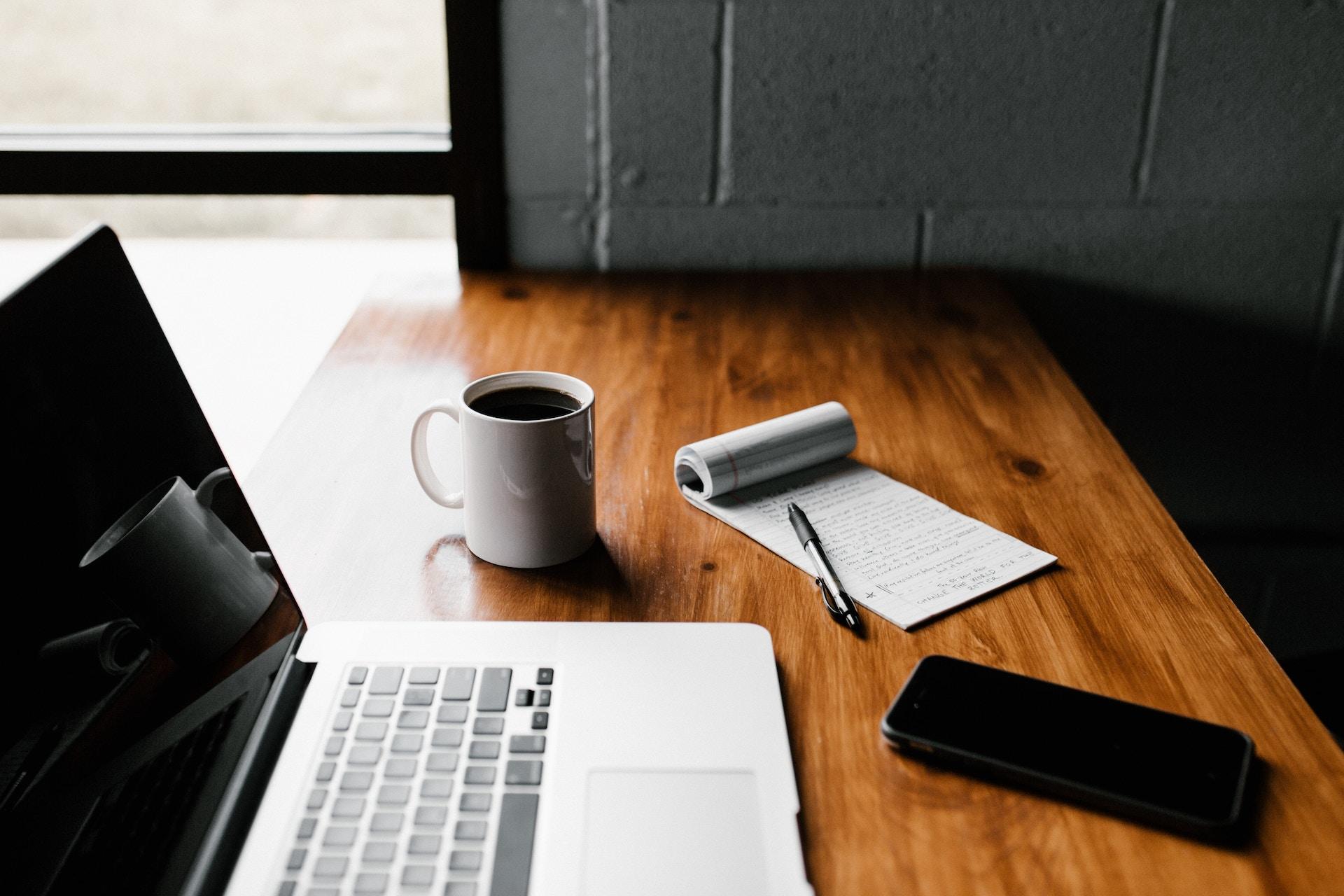 laptop coffee mug working on desk