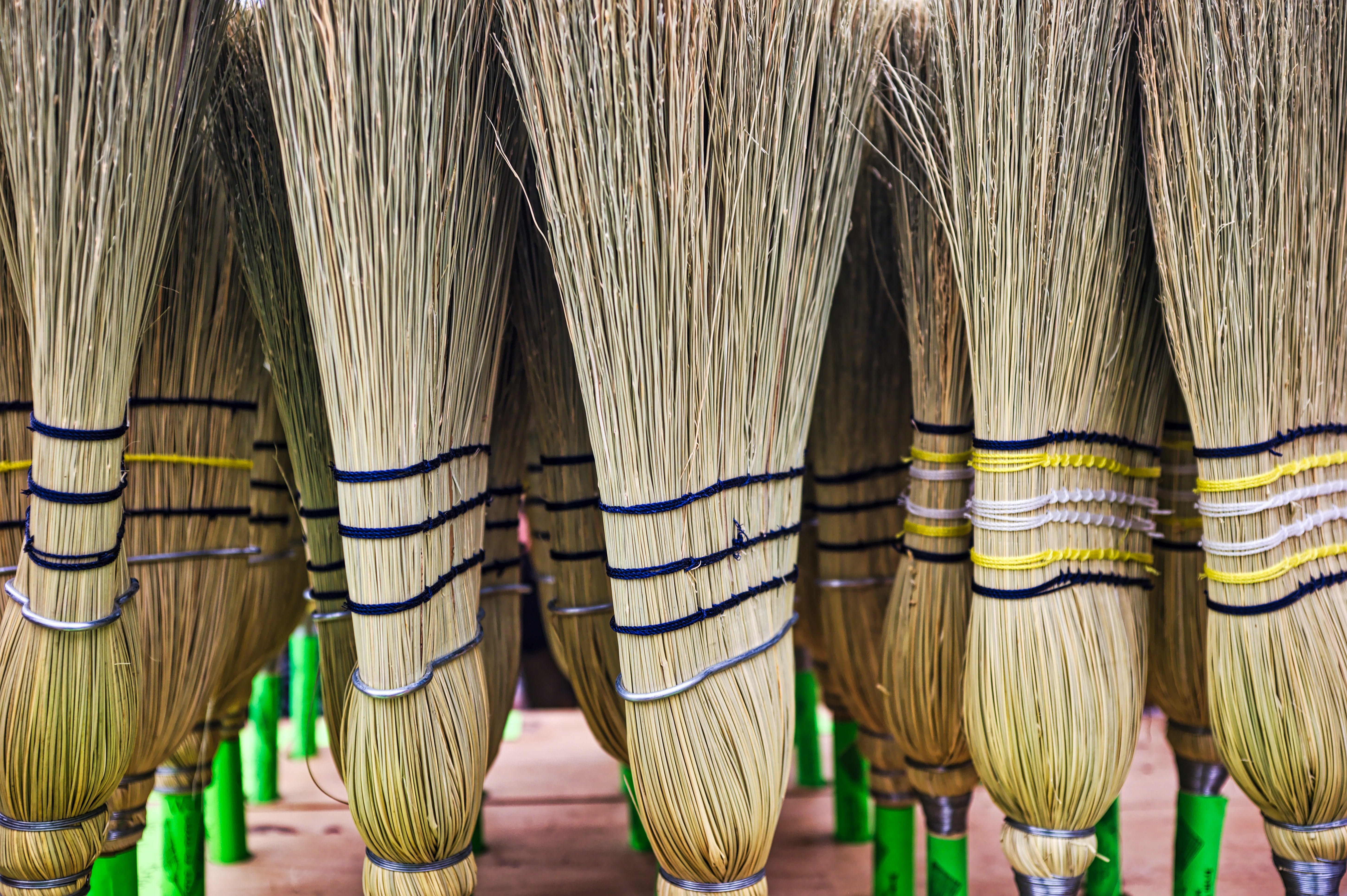 Row of traditional looking brooms