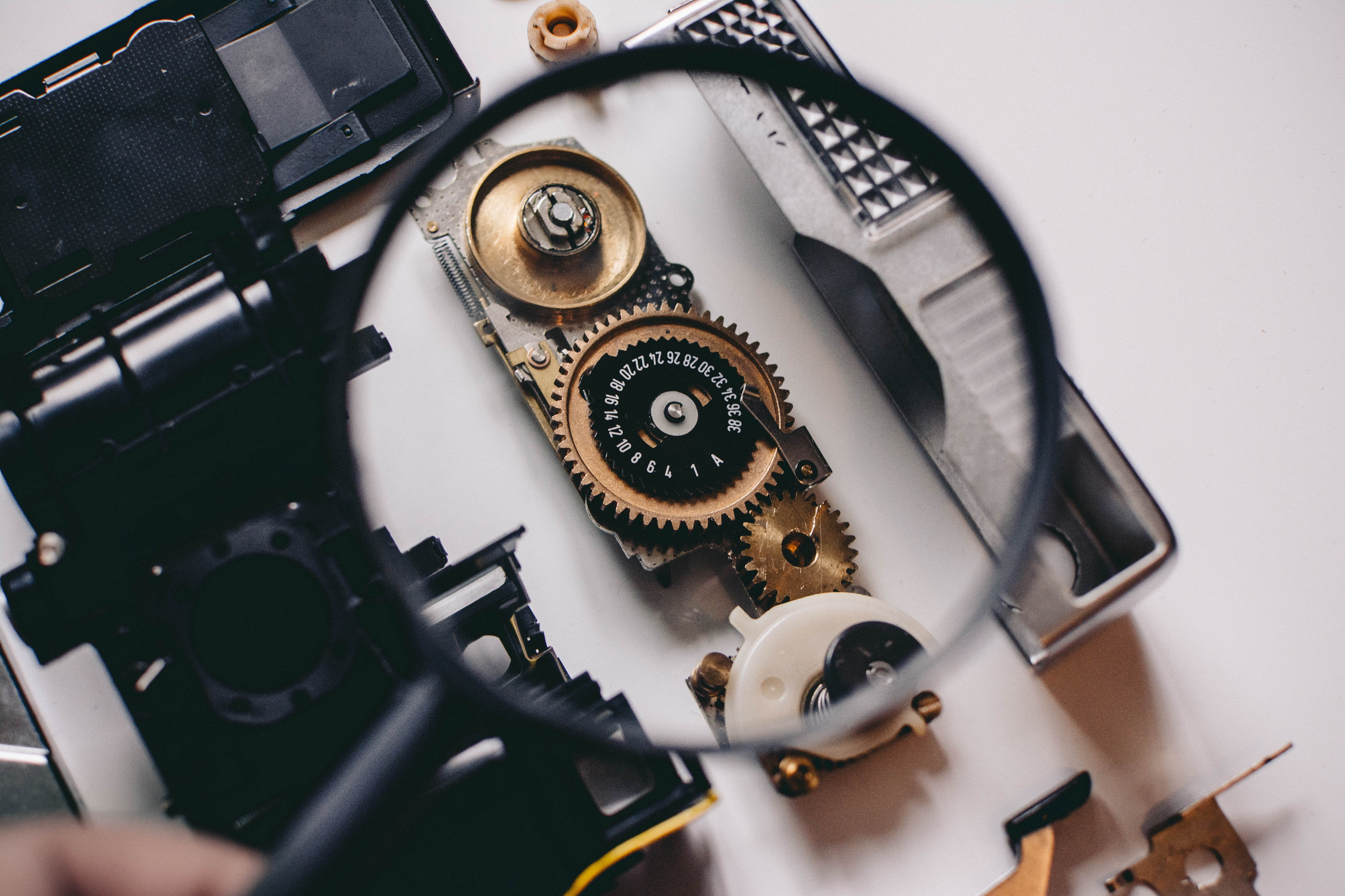 Magnifying glass inspecting mechanical parts