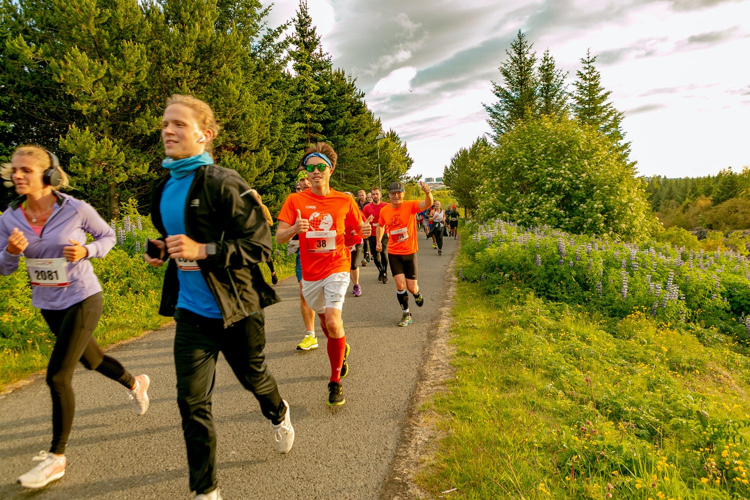 Happy runners in Elliðaárdalur valley