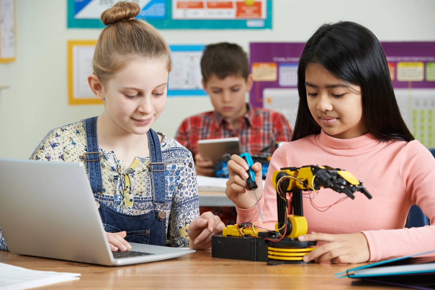 two children working on a robot
