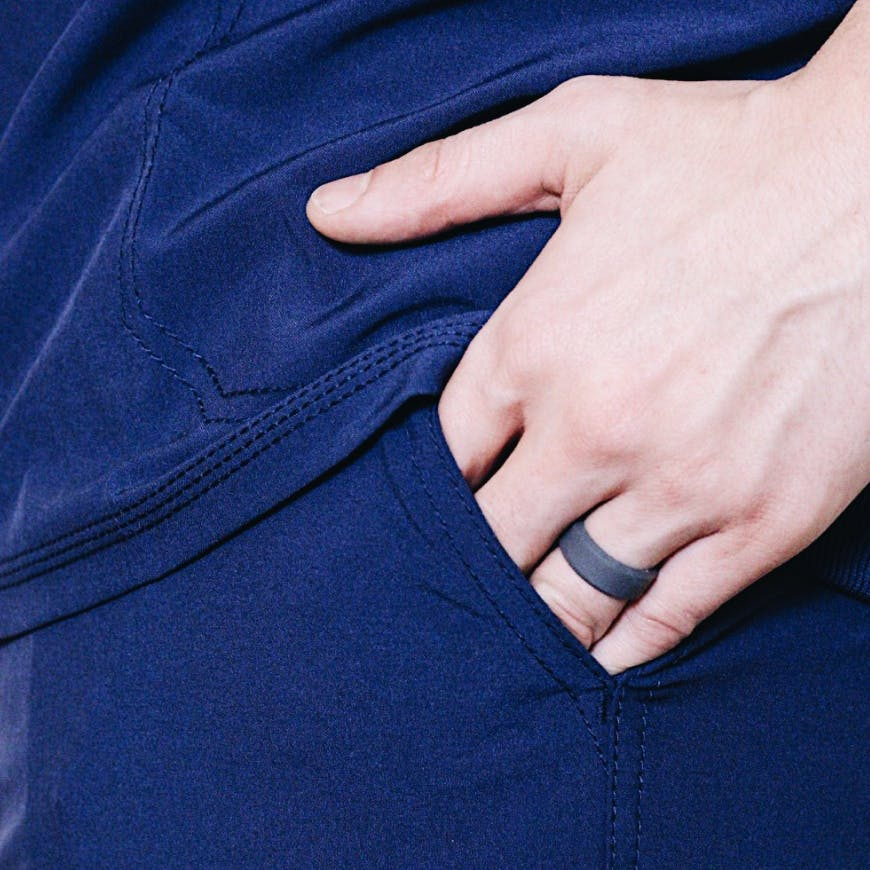 Nurse wearing an enso ring with hands in pockets