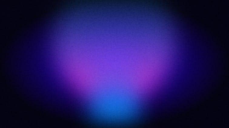 中央に光る紫とピンクの灯りのある暗めの紺色の背景