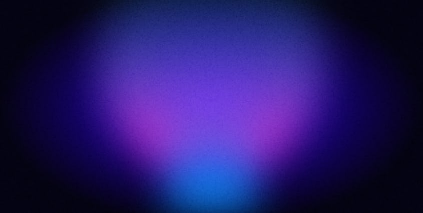 Dark navy background with glowing purple and pink lights in the center