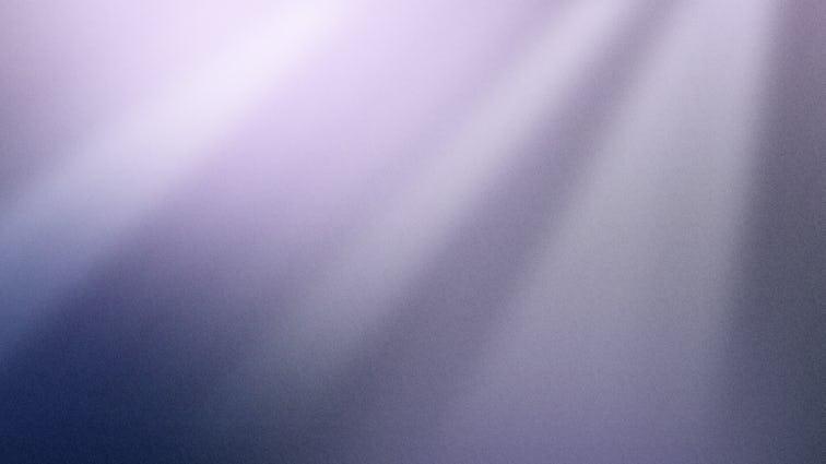 上から白い光のビームを受けたバイオレットの背景
