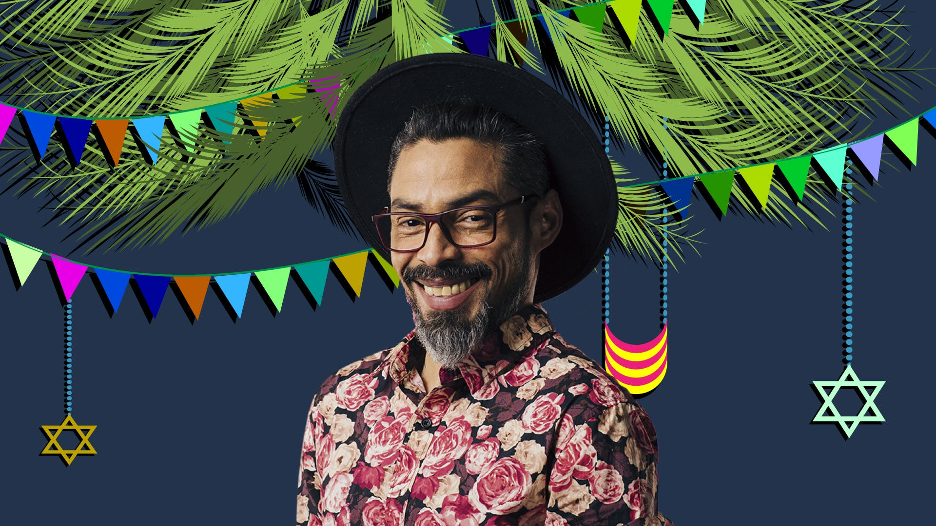 Smiling man with glasses against Sukkot background with flags, stars of David, and plant materials