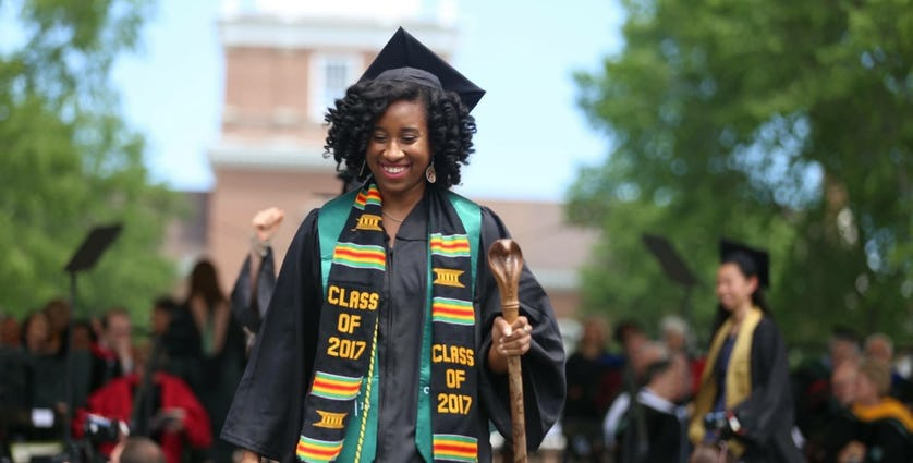 Kaya Thomas wears a cap and gown at her 2017 graduation from Dartmouth College.