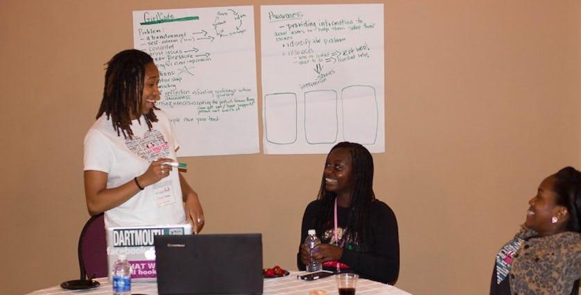 Kaya Thomas mentors her hackathon team at the Black Girls Code NOLA hackathon