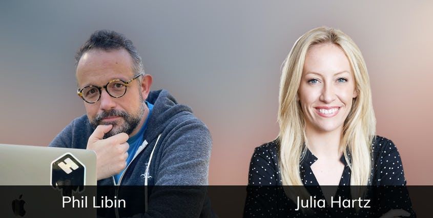 Phil Libin wearing glasses with hand on chin and Julia Hartz smiling