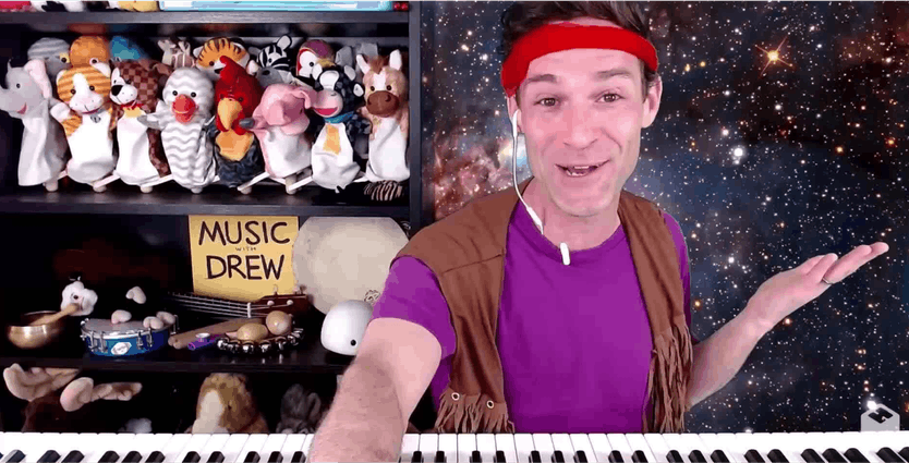 Music with Drew man in front of case with puppets
