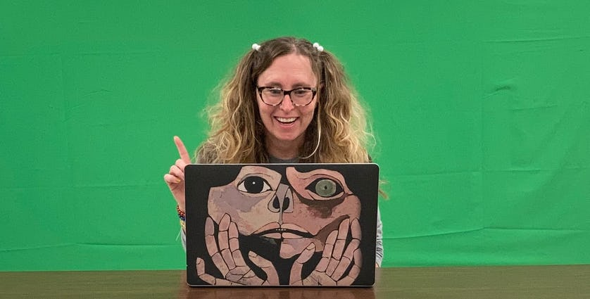 Lorrie Salome sitting in front of a green screen