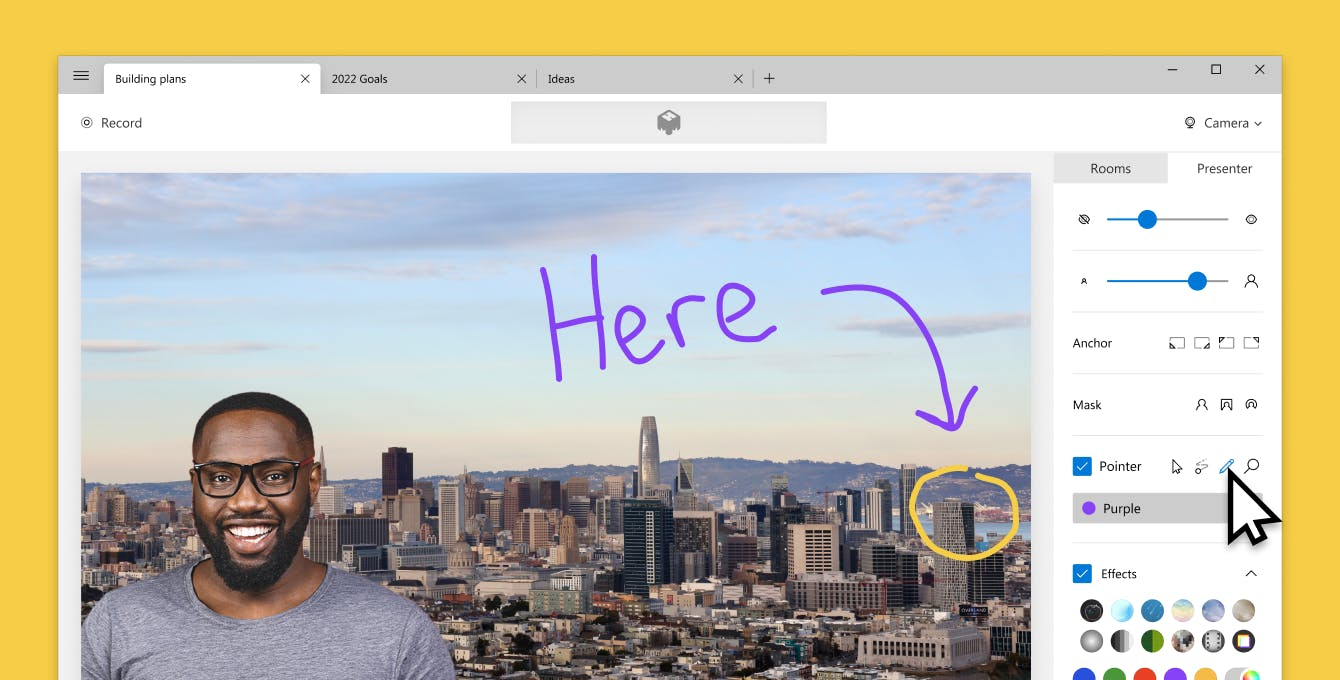 Screenshot of mmhmm with man standing in front of a city background with a drawing of the word