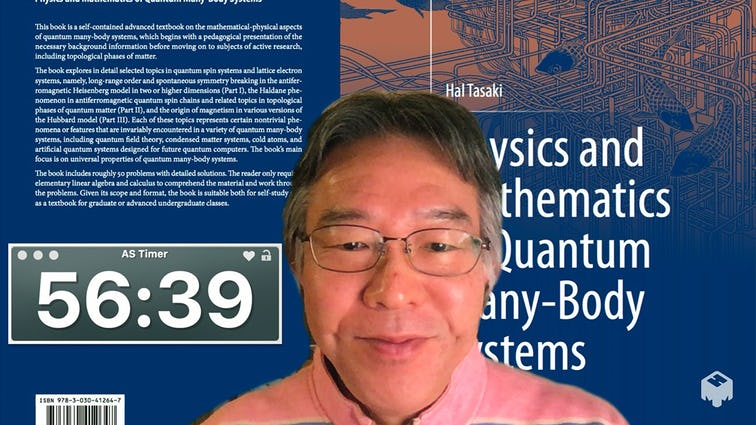 Mr. Tasaki with a timer displayed behind him