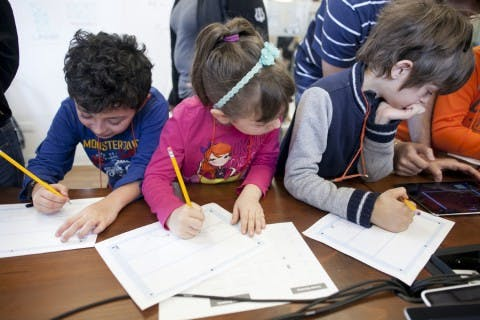 Kids writing and drawing