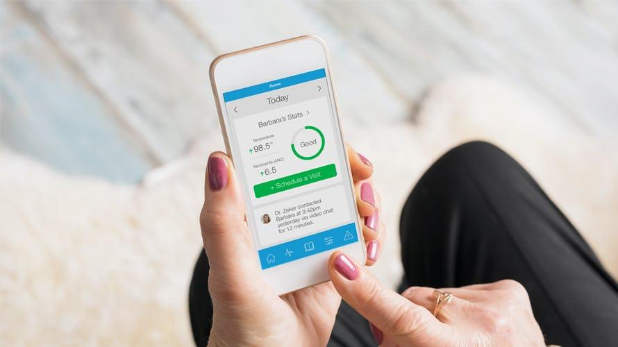 A woman using keymoment mobile app