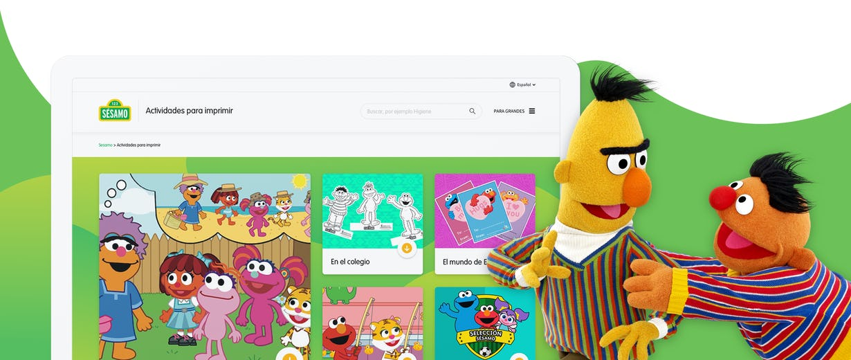 Bert y Ernie From Sesame Street playing in the right and a computer screen with the Sesame site in the left