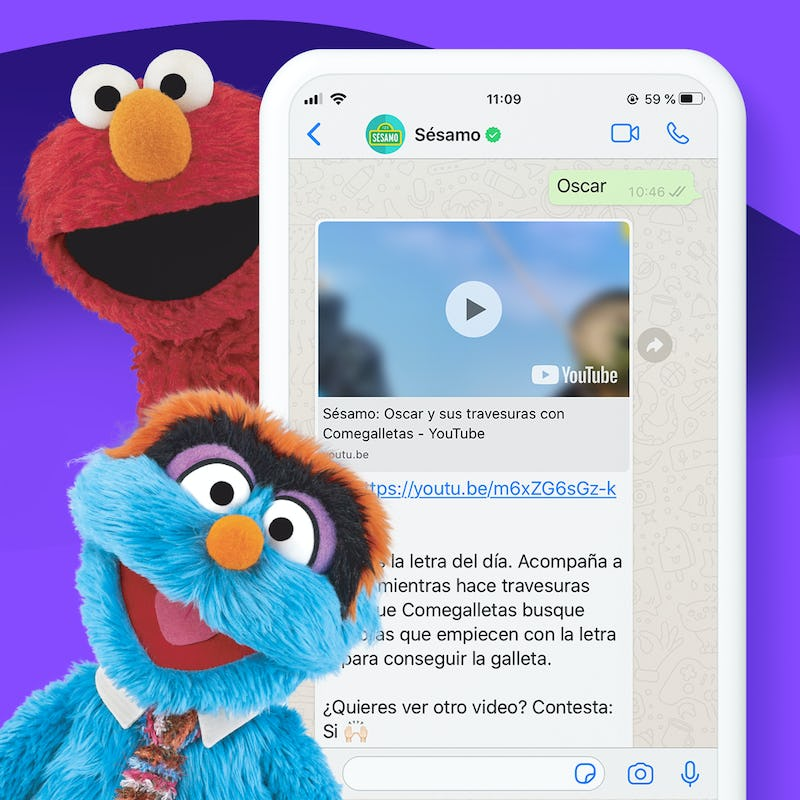 elmo and another Sesame Street character next to a phone with the Whatsapp experience